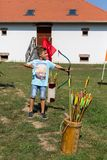 Nyiregyhaza, Hungary. Boy shoots arrows with a bow at a festival in the ethnic museum of Nyiregyhaza city. Nyiregyhaza, Hungary, September 10, 2017. Boy shoots Stock Photo