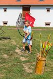 Nyiregyhaza, Hungary September 10, 2017. Boy shoots arrows with a bow at a festival royalty free stock photos