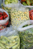 Nylon bags with vegetables. On the market Royalty Free Stock Images