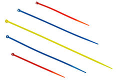 Nylon cable ties. Multicolor nylon cable ties on white background royalty free stock photos