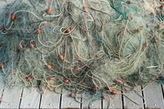 Nylon fishing net with buoys on wooden background. Of dock stock photos