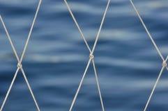 Nylon mesh. On sea background Royalty Free Stock Images