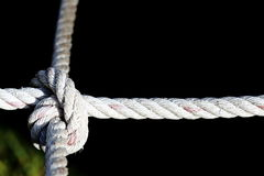 Nylon Rope Knot four ways, difficult hard to solve, black backgr Royalty Free Stock Photos