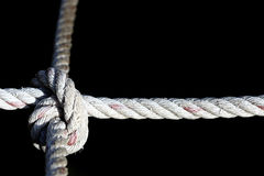 Nylon Rope Knot four ways, difficult hard to solve, black backgr Royalty Free Stock Image