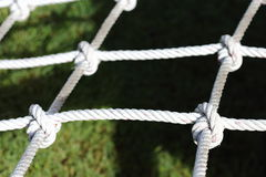 Nylon Rope Knot four ways, difficult hard to solve, black backgr Royalty Free Stock Images