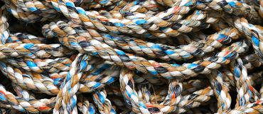 Nylon rope for sea fishermen in the harbour area. Sturdy hemp rope for fishermen in the harbour area Royalty Free Stock Images