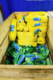 Nylon soft lifting slings stacked in a wooden box. Warehouse of finished products for industrial enterprises Royalty Free Stock Photo