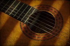 Nylon string guitar and light Royalty Free Stock Photo