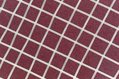 Nylon strings over a maroon background Stock Images