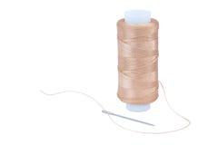 Nylon thread with a needle Royalty Free Stock Photos