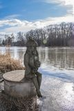 Sculpture of czech water spirit Vodnik in Nymburk. Nymburk, Czech republic - 24. february 2018: Sculpture of czech merman on river Elba at winter day. Vodnik stock photos