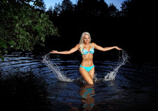 Nymph. Beautiful fairy girl in blue bikini by the lake Royalty Free Stock Photos