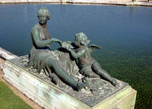 Nymph and Child Statue at Palace of Versailles Stock Photography