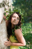 Nymph hugging a tree Royalty Free Stock Images