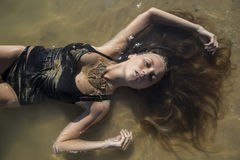 Nymph lying in water Royalty Free Stock Images