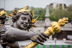 The Nymph statue on the bridge of Alexander III in Paris, France stock photo