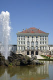 Nymphenburg. Castle in munich, bavaria, behind a fountain Stock Photo