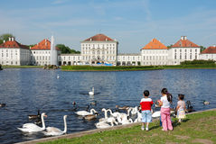Nymphenburg Castle. With lake and kids in front Royalty Free Stock Image