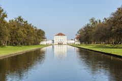 Nymphenburg castle grounds in Munich with reflection in lake, Ge Royalty Free Stock Photos