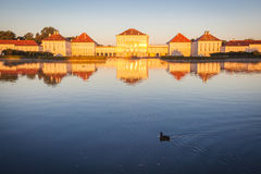 Nymphenburg Palace in Munich. Nymphenburg palace with reflection in the morning sunlight Stock Photo