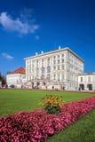 Nymphenburg slott med den kungliga trädgården i Munich, Tyskland Arkivfoto