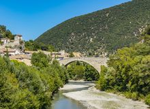 The Nyons Bridge is a medieval bridge over the river Eygues in N stock photo