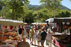 Nyons market, Provence, France. Shoppers at Nyons open-air market, Provence, France Stock Images