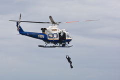 NYPD Air Sea Rescue. NYPD Helicopter raises police diver during air-sea rescue operations royalty free stock photos