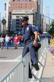 NYPD-ambtenaar tijdens LGBT Pride Parade in NY Stock Foto