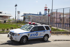 NYPD car providing security at Coney Island section of Brooklyn Stock Photos