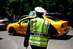 NYPD Cop Directing Traffic in NYC. NYPD Police man directing trafficin NYC Royalty Free Stock Images