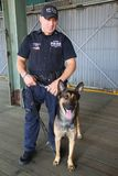 NYPD counter terrorism bureau K-9 police officer and K-9 dog providing security in New York. NEW YORK - SEPTEMBER 5, 2017: NYPD counter terrorism bureau K-9 Stock Image