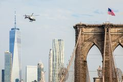 A NYPD helicopter flying along the East River royalty free stock images