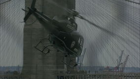 NYPD Helicopter flying beside bridge. stock video footage