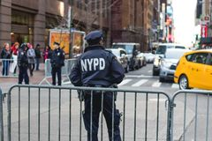 NYPD officer in new york city stock photos