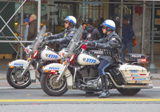 NYPD officers on motorcycles providing security in Manhattan Stock Photos
