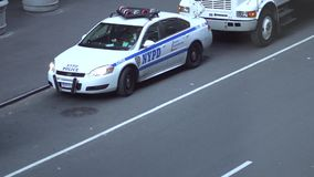 NYPD officers near police car stock video