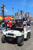 NYPD officers providing security at Coney Island Boardwalk  in Brooklyn Royalty Free Stock Image