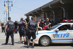 NYPD officers providing security at Coney Island Boardwalk in Brooklyn royalty free stock photos