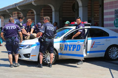 NYPD officers providing security at Coney Island Boardwalk  in Brooklyn Royalty Free Stock Images
