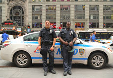 NYPD officers providing security at the Times Square Stock Images