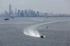 NYPD Police Boat Speeding Away from City Stock Photo