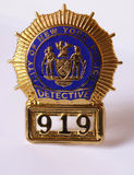 Nypd police detective badge. Close up on white background royalty free stock photography