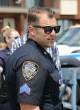 NYPD police officer provides security during Bay Fest street festival on Sheepshead Bay in Brooklyn. BROOKLYN, NEW YORK - MAY 20, 2018: NYPD police officer royalty free stock photos