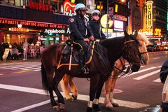 NYPD police officers on horse back in Times Square New York City Stock Image