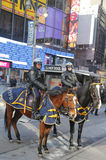 NYPD police officers on horseback ready to protect public on Broadway during Super Bowl XLVIII week in Manhattan Stock Photo