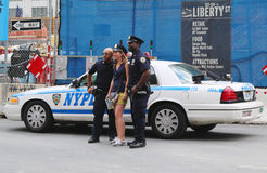 NYPD Police Officers taking picture with tourist near World Trade Center in Manhattan Stock Images