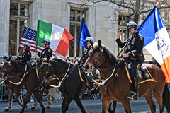 NYPD in Saint Patrick's Day Parade. Mounted Police March in Parade Carrying Flags - Circa 2011 Royalty Free Stock Images