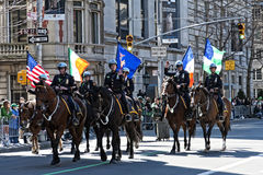 NYPD in Saint Patrick's Day Parade. Mounted Police March in Parade Carrying Flags - Circa 2010 Royalty Free Stock Image
