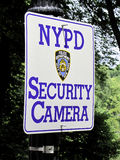 NYPD security camera. Sign, this sign discloses the location of a crime deterrent security camera place by the New York City Police Department Royalty Free Stock Photo